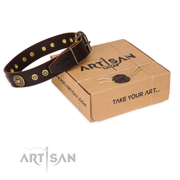Genuine leather dog collar made of soft to touch material with rust resistant hardware